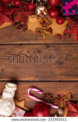chocolate with hazelnuts on a wooden background #231983611
