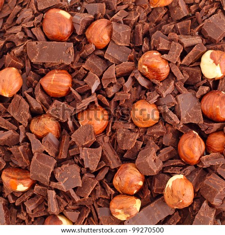Chocolate with nuts and apricots background