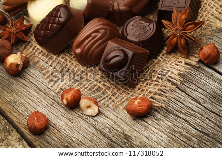 chocolate with nuts on the wooden background
