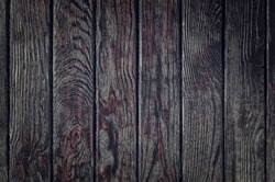 Chocolate wood texture. Creatively painted dark brown background.