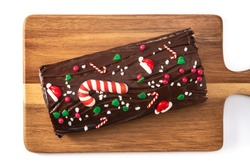 Chocolate yule log christmas cake isolated on white background. Top view