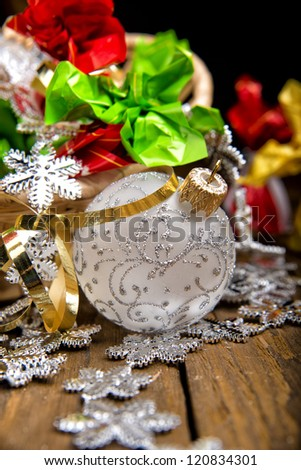 chocolates and Christmas decorations for the Christmas tree on a wooden table. Christmas collection of sweets