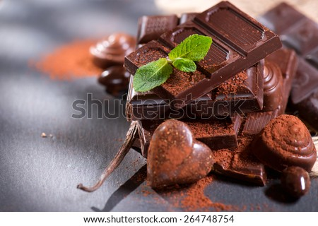 Chocolates. Chocolate. Assortment of fine chocolates in white, dark, and milk chocolate. Variety of Praline Chocolate sweets