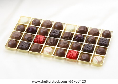 Chocolates in a nice box isolated on white cloth background