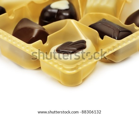 Chocolates in box isolated on a white background