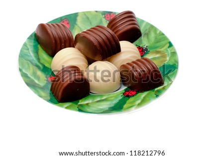 Chocolates on a plate, isolated on a white background