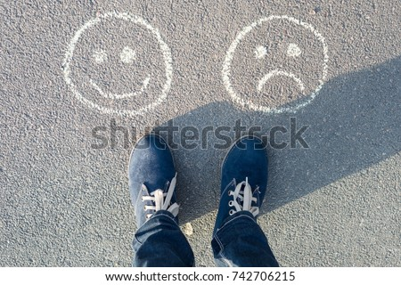 Choice - Happy Smileys or Unhappy, text on asphalt road #742706215