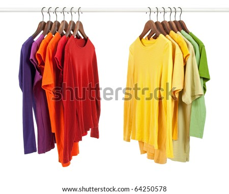 Choice of clothes of different colors on wooden hangers, isolated on white.