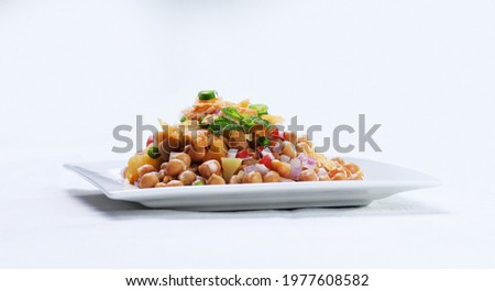 Chola Chana Chaat, Bowl of Chickpeas curry or Chola masala. Ramadan Iftari Dinner. Ramzan Meal. Specially for Eid, Diwali or Christmas. Top Refreshment for Roza Iftar. Famous Indian street food