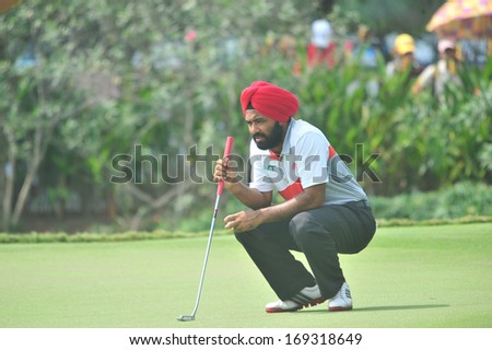 CHONBURI - DECEMBER 14 : Sujjan Singh in aciton during Thailand Golf Championship 2013 at Amata Spring Country Club on December 14, 2013 in Chonburi, Thailand.