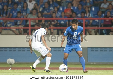 CHONBURI THAILAND - APRIL 24 : Unidentified player in AFC CUP 2012 between Chonburi F.C. (blue) VS Yangon United (white) at Chonburi stadium on April 24,2012 in Chonburi,Thailand.