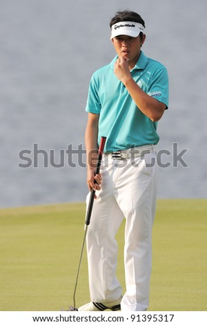 CHONBURI, THAILAND - DECEMBER 15:Ben LEONG of Malaysia plays a shot during day one of the Thailand Golf Championship at Amata Spring Country Club on December 15, 2011 in Chonburi, Thailand.