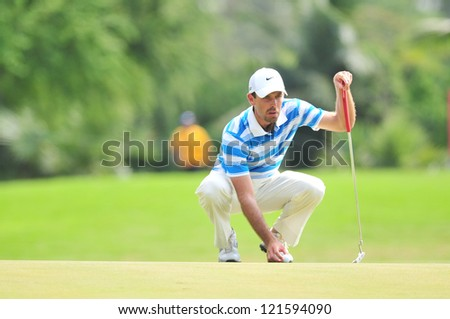 CHONBURI, THAILAND - DECEMBER 8 : Charl Schawartzel in action during The Golf Championship Thailand Round 3 at Ammata Spring Country Club on December 8, 2012 in Chonburi, Thailand.