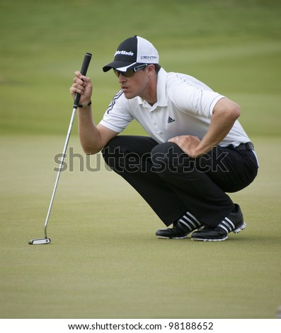 CHONBURI, THAILAND - DECEMBER 15: Darren Beck of Australia thinks of his next move during Day 1 of Thailand Golf Championship on December 15, 2011 at Amata Spring Country Club in Chonburi,Thailand