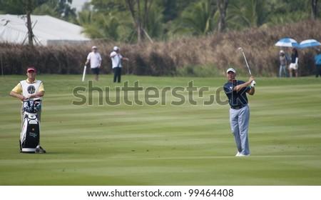 CHONBURI, THAILAND - DECEMBER 15: Darren Clarke of Northern Ireland in action during Day 1 of Thailand Golf Championship on December 15, 2011 at Amata Spring Country Club in Chonburi, Thailand