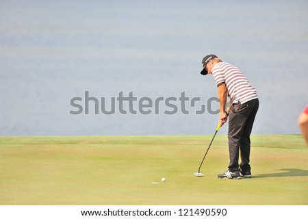 CHONBURI, THAILAND - DECEMBER 8 : Joonas Granberg in action during The Golf Championship Thailand Round 3 at Ammata Spring Country Club on December 8, 2012 in Chonburi, Thailand.