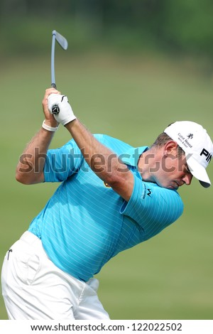 CHONBURI,THAILAND-DECEMBER 6: Lee Westwood of England hits a shot during day one of the Thailand Golf Championship at Amata Spring Country Club on Dec 6,2012 in,Thailand.