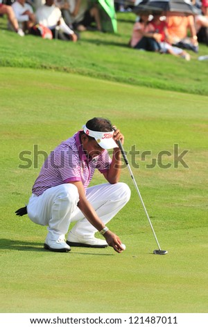 CHONBURI, THAILAND - DECEMBER 8 : Thaworn Wiratchant in action during The Golf Championship Thailand Round 3 at Ammata Spring Country Club on December 8, 2012 in Chonburi, Thailand.