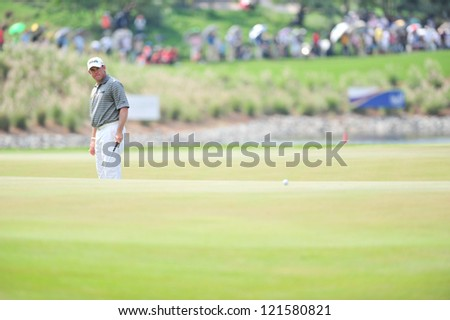 CHONBURI, THAILAND - DECEMBER 8 : Unidentified Athlete in action at the Golf Championship Thailand Round 3 at Ammata Spring Country Club on December 8, 2012 in Chonburi, Thailand. - stock photo