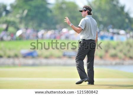 CHONBURI, THAILAND - DECEMBER 8 : Unidentified Athlete in action at the  Golf Championship Thailand Round 3 at Ammata Spring Country Club on December 8, 2012 in Chonburi, Thailand.