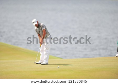 CHONBURI, THAILAND - DECEMBER 8 : Unidentified Athlete in action at the  Golf Championship Thailand Round 3 at Ammata Spring Country Club on December 8, 2012 in Chonburi, Thailand.