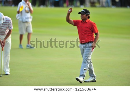 CHONBURI, THAILAND - DECEMBER 8 : Unidentified athlete in The Golf Championship Thailand Round 3 at Ammata Spring Country Club on December 8, 2012 in Chonburi, Thailand. - stock photo