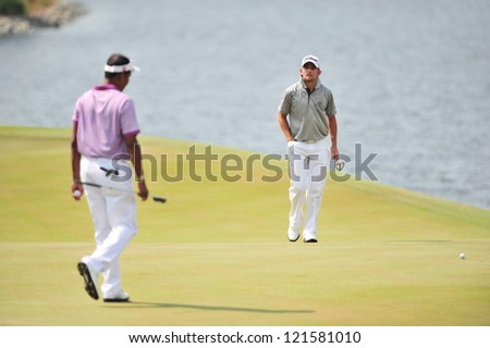 CHONBURI, THAILAND - DECEMBER 8 : Unidentified athlete in The Golf Championship Thailand Round 3 at Ammata Spring Country Club on December 8, 2012 in Chonburi, Thailand.