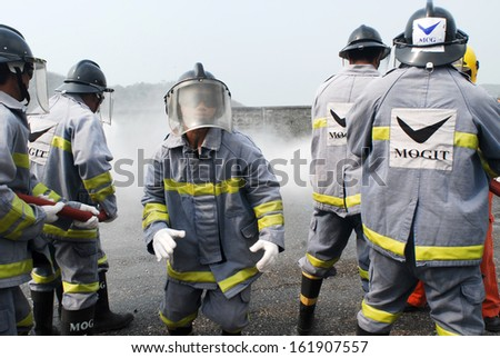 CHONBURI, THAILAND - FEBRUARY 05: Rig workers team training with real fire before work in offshore rig at Chonburi on February 5, 2008 in Chonburi, Thailand.