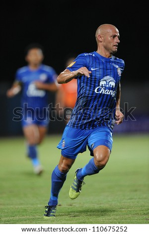CHONBURI,THAILAND-14 JULY:Geoffrey Doumeng (blue) of Chonburi fc. in action during Thai Premier League between Chonburi fc.and Samut Songkhram fc.at Chonburi Stadium on July 14,2012 in Thailand