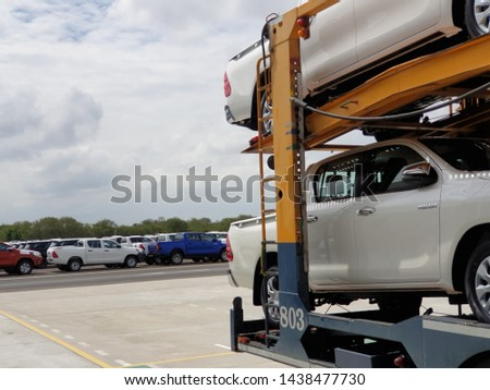 Chonburi, Thailand - July 1, 2019: New Toyota cars are parking in the yard and waiting to send to destination. Completed cars are waiting to move to destination. #1438477730