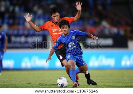 CHONBURI,THAILAND-14 JULY:Nurul Sriyankem(blue)of Chonburi fc.for the ball during Thai Premier League between Chonburi fc.and Samut Songkhram fc.at Chonburi Stadium on July 14,2012 in Thailand