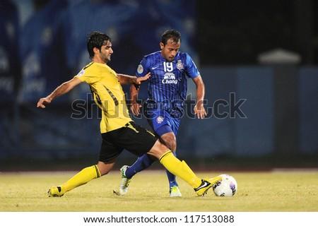 CHONBURI,THAILAND-OCTOBER 23:Adul Lahso(blue) of Chonburi F.C. in action during the AFC CUP  between Chonburi F.C.and Arbil S.C.(IRQ) at Chonburi Stadium on Oct 23,2012 in Thailand