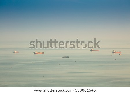 CHONBURI,THAILAND - OCTOBER 29 : The oil vessel is anchored  in sea shore in twilight time on October 29, 2015 in Chonburi, Thailand