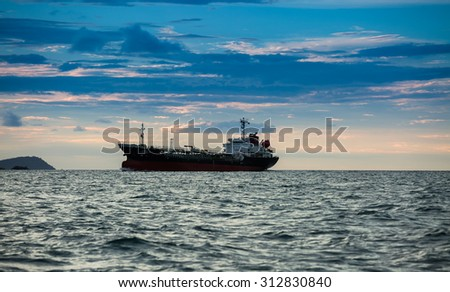 CHONBURI,THAILAND - SEPTEMBER 2 : The oil vessel is sailing in sea shore in twilight time on September 2, 2015 in Chonburi, Thailand