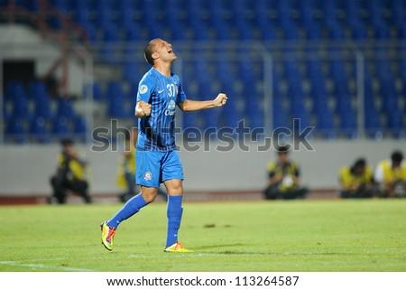 CHONBURI,THAILAND-SEPTEMBER18:Thiago Cunha of Chonburi fc. celebrates after scoring  during the AFC CUP  between Chonburi fc.and Al Shorta(SYR) at Chonburi Stadium on Sep18,2012 in Thailand