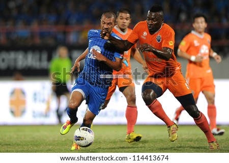 CHONBURI,THAILAND-SEPTEMBER11:Yves Ekwalla Herman(Orange)of Buriram Utd.compete for the ball during Thai Premier League between Chonburi fc.and Buriram Utd.at Chonburi Stadium on Sep11,2012 inThailand
