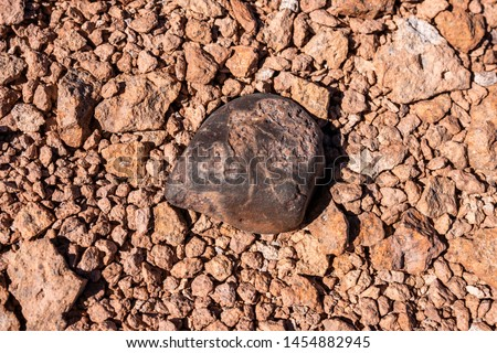 Photo of  Chondrite Meteorite L Type, a piece of rock formed in outer space in the early stages of Solar System as asteroids. This meteorite comes from a meteorite fall impacting the Earth at Atacama Desert