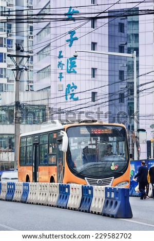 CHONGQING-NOV. 4, 2014. Public transport. Most popular transport mode is public bus. Start price is CNY 1 for common buses and CNY 1.5 for air-conditioned buses. Running hour buses is 5:30 to 21:00.