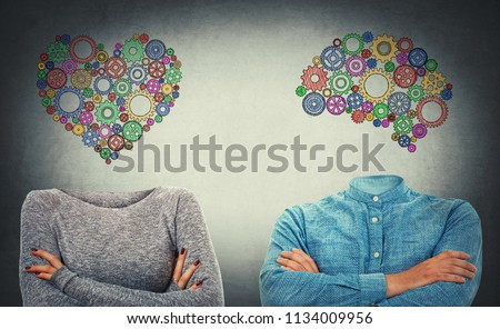 Choose between heart and mind. Incognito man and woman with crossed hands and drawn cog brain and heart symbol instead of head. Human character, emotions and thinking concept. Introvert and extrovert.