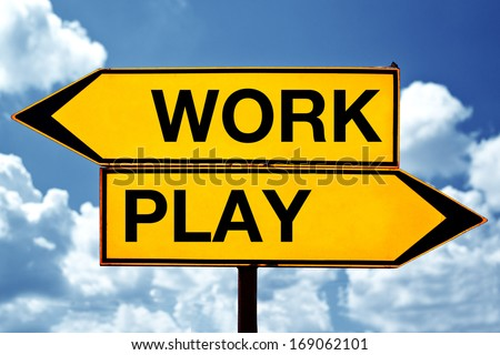 Choose between Work and play, opposite direction signs. Concept of choice.