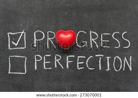 choose progress not perfection concept handwritten on blackboard with heart symbol instead of O