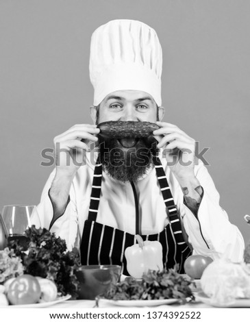 Choose vegetarian lifestyle. Man cook hat apron hold fresh vegetables. Vegetarian recipe concept. Vegetarian restaurant. Buy fresh vegetables grocery store. Hipster chief chef vegetarian cafe.