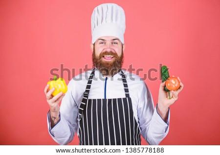 Choose vegetarian lifestyle. Man cook hat apron hold fresh vegetables. Vegetarian recipe concept. Buy fresh vegetables grocery store. Vegetarian restaurant. Hipster chief chef vegetarian cafe.