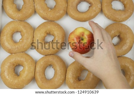 Choosing An Apple Instead Of Donuts