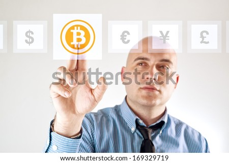 Choosing bitcoins as currency over other, businessman pressing touch screen button.