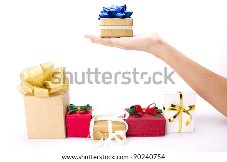 choosing gift, female hand choosing gold with blue ribbon gift box