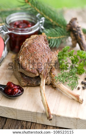 Chop of venison on wooden ground
