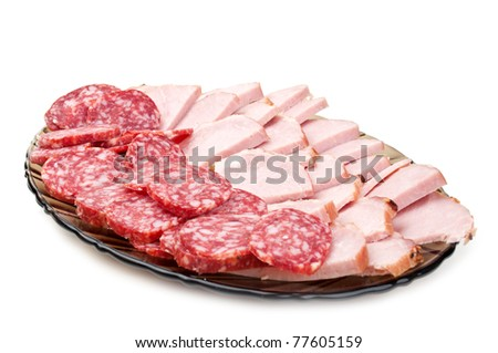 chopped bacon and salami on a plate isolated on a white background