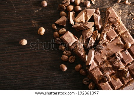 Chopped bar of chocolate on wooden background #192361397