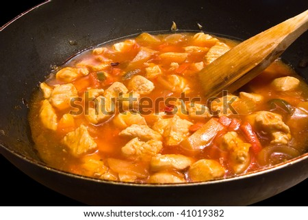 chopped chicken cooking in a sweet and sour sauce, chinese food